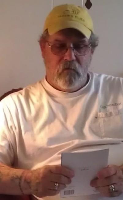 Steven Utley reading a 58th birthday card